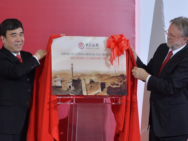 Tian Guoli und Dusan Vujovic