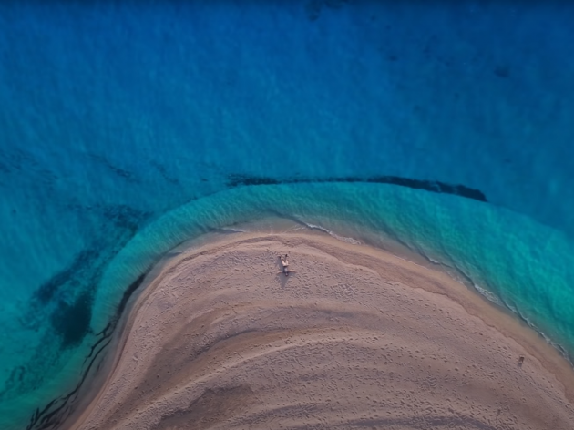Where is the mysterious beach which can be seen in all Greece ads located?