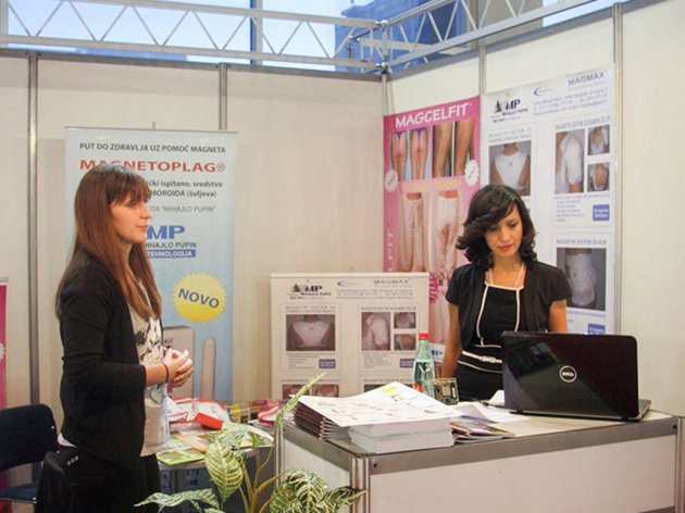 Jelena Vasiljevic, on the right, atthe stand of the Mihajlo Pupin Institute, at the Fair of medicine andstomatology