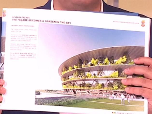 President Aleksandar Vucic showing photograph of national stadium